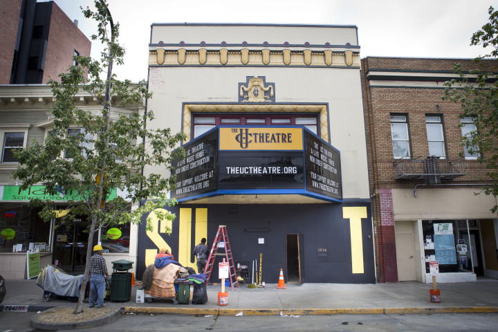 Rich Black paints a mural on the UC Theater on May 22, 2015. Photo: Melati
