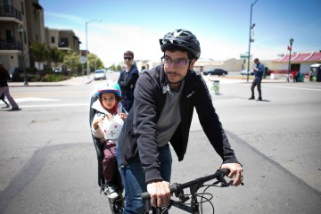 Father and daughter bike through the East Bay Open Streets fest 5/30/15 Photo: Melati Citrawireja