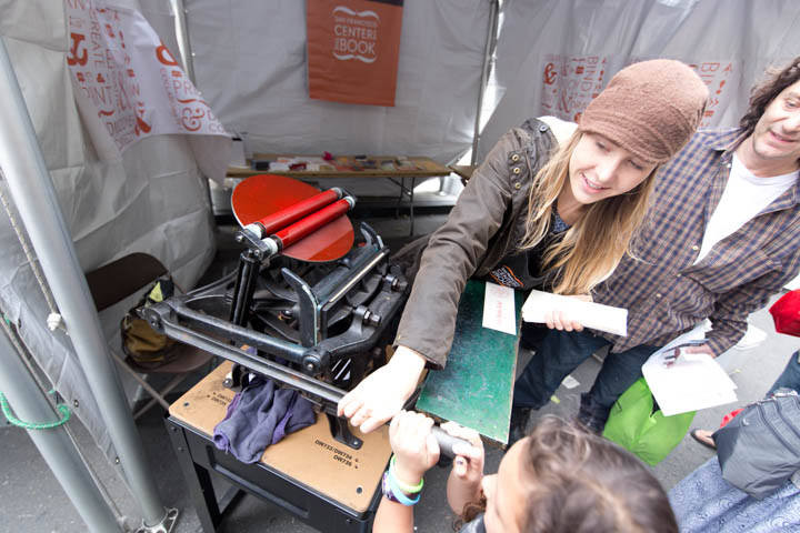 Trying out a printing press at the 2015 Bay Area Book Festival. Photo: Ira Serkes