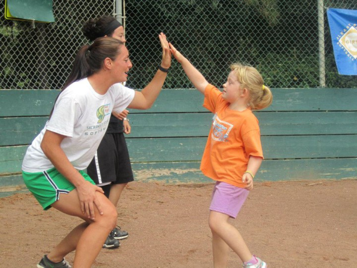 An ABGSL coach and player high-five after a play. Photo: ABGSL