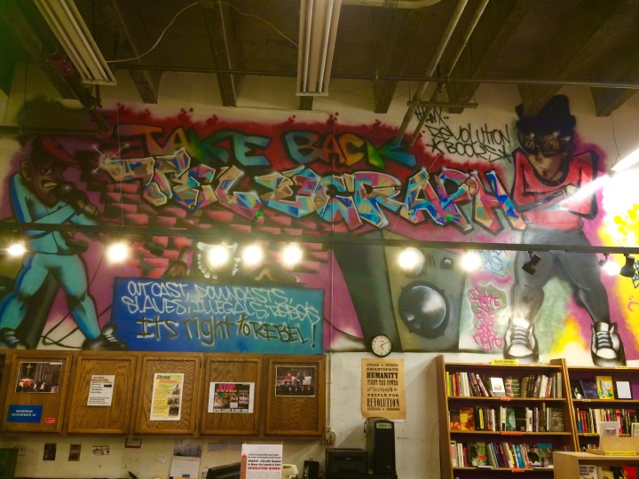 A graffiti piece from 1988 lining the wall will stay behind at Revolution Book's old location. Photo: Emily Dugdale