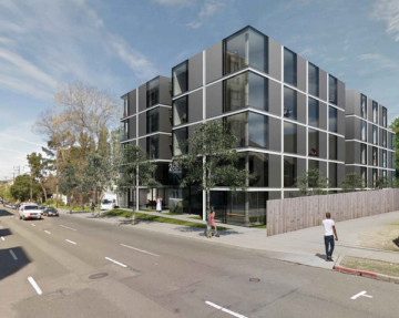 The planned five story apartment building. The owner wants to demolish the current structure and build from scratch.