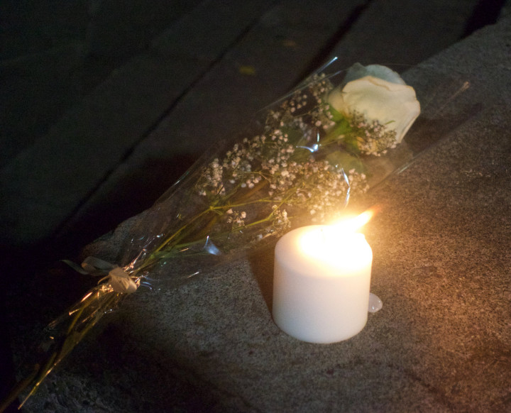 A candle and flowers left to remember those killed in the balcony collapse. Photo: Ted Friedman