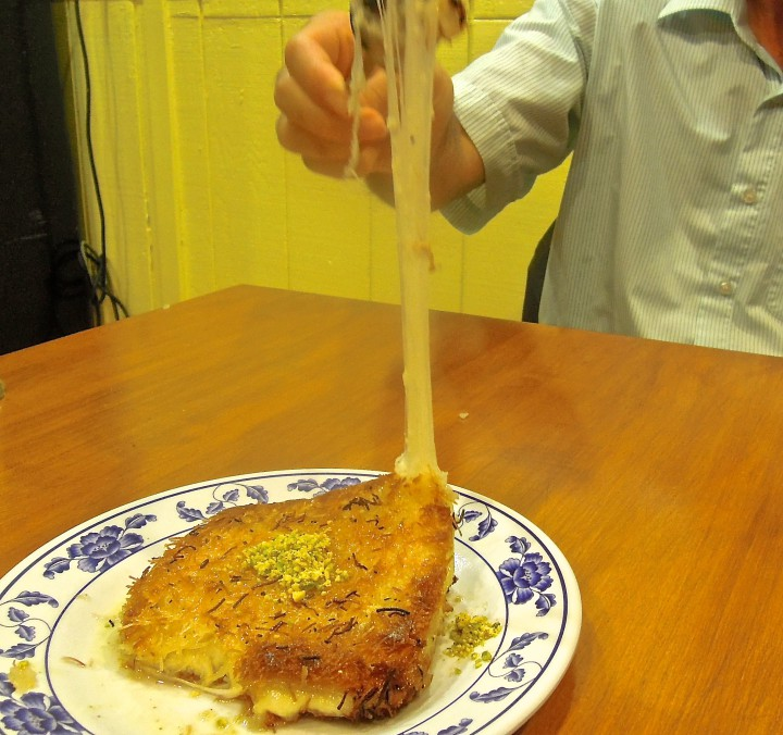 Kobani's Kunefe, a warm dessert of sweet shredded fill dough, stuffed with cheese. Photo: Anna Mindess