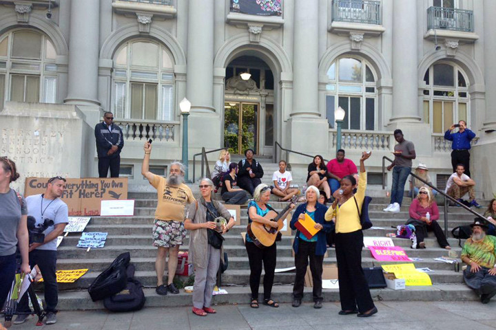 Community members opposing what they say is Berkeley's attempt to criminalize homelessness rallied in front of Old City Hall on Tuesday night. Photo: Tracey Taylor