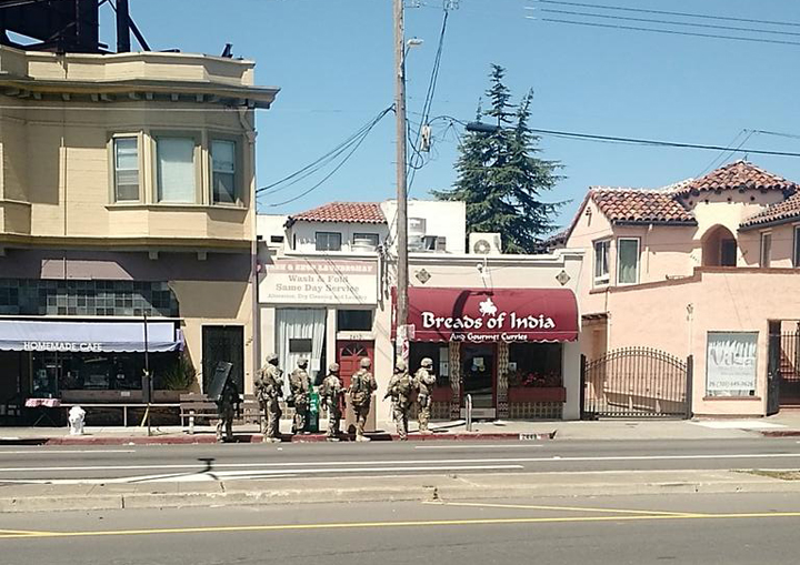 The Berkeley Police Special Response Team searching for an armed robber near Sacramento Street last Monday. Photo: Tomas/tvspike1
