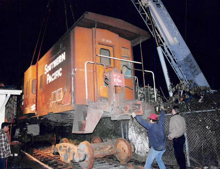 Caboose lifted onto driveway tracks at 1406 5th Street.. Photo courtesy of Rob Garross.