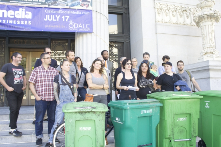 Oakland restaurant owners gathered by its city hall steps to protest a sharp rise in compost fees. Gail Lilian, owner of Liba Falafel and organizer of the protest, speaks. Photo: Seung Y. Lee