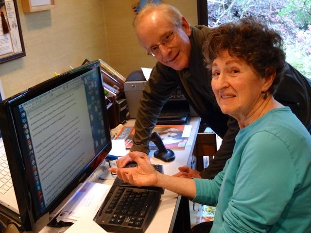 At Ashby Village, volunteer Mark Goldman helps Chana Bloch with her computer. Photo: Ashby Village