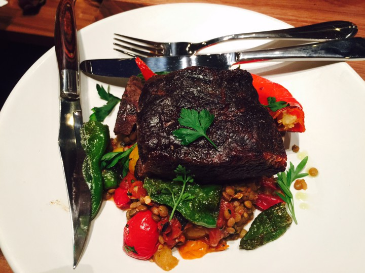 Wood-grilled beef shortrib with stewed peppers, eggplant and lentils ($29) at The Advocate. Photo: Frances Dinkelspiel