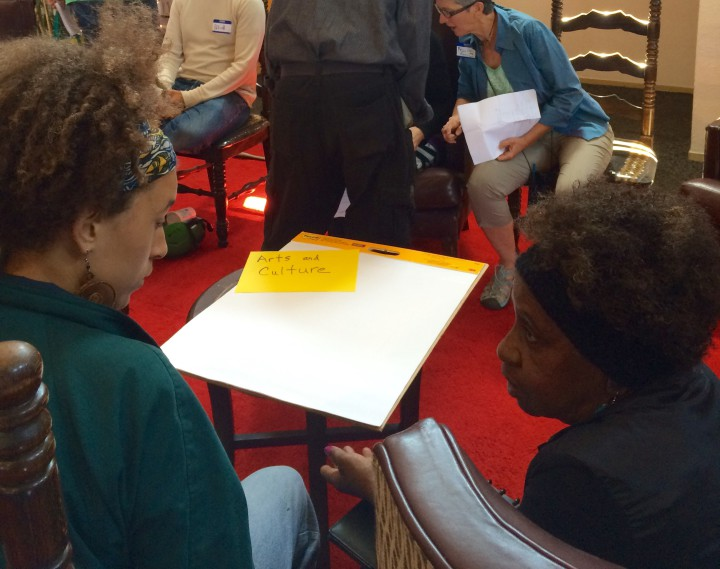 A group facilitator and a community member converse during the breakout session. Photo: Emily Dugdale