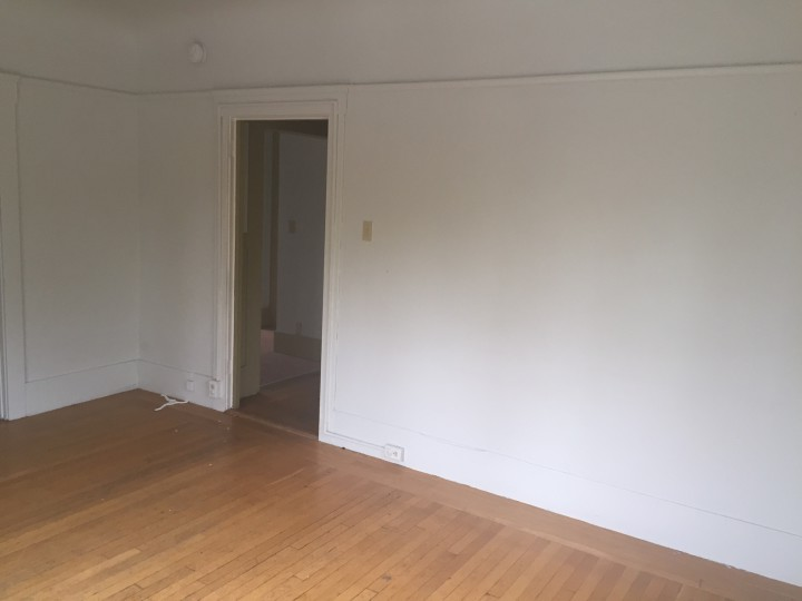 "This is the ""before"" picture of the living room at McKinley House. Photo: BOSS"