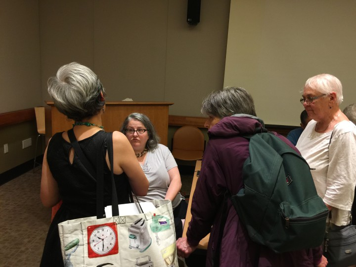 As soon as the BOLT meeting ended, members of the library staff rushed over to talk to Dentan to give her feedback on her presentation. Photo: Frances Dinkelspiel
