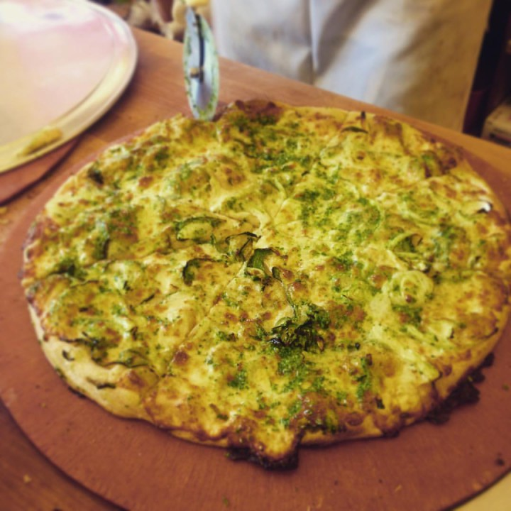 Pasilla pepper, onion and cilantro pesto pizza from Arizmendi. Photo: Arizmendi/Facebook