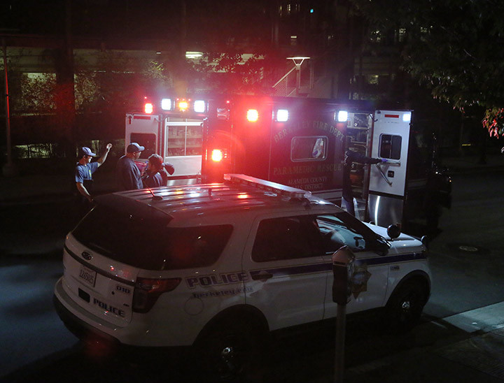 Emergency personnel respond to an alcohol poisoning call in the courtyard of the Unit 1 dorms at the University of California, in Berkeley, early Tuesday, Aug. 25. The call came in as a possible alcohol poisoning case involving a 20-year-old male who was vomiting. Photo: David Yee
