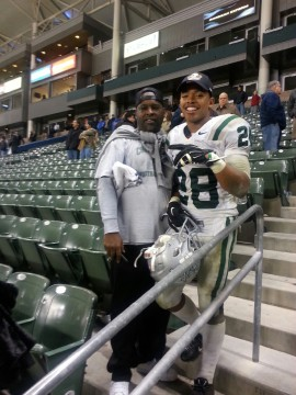 Antione Custer(28) and his father after the North Coast Section Division 1 champion