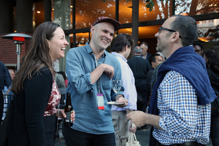 Speaker Robin Sloan talks with festivalgoers at the Uncharted 2015 party. Photo: Kelly Sullivan
