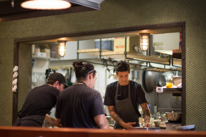 Cooks busy in the kitchen at Ramen Shop. Photo: Benjamin Seto