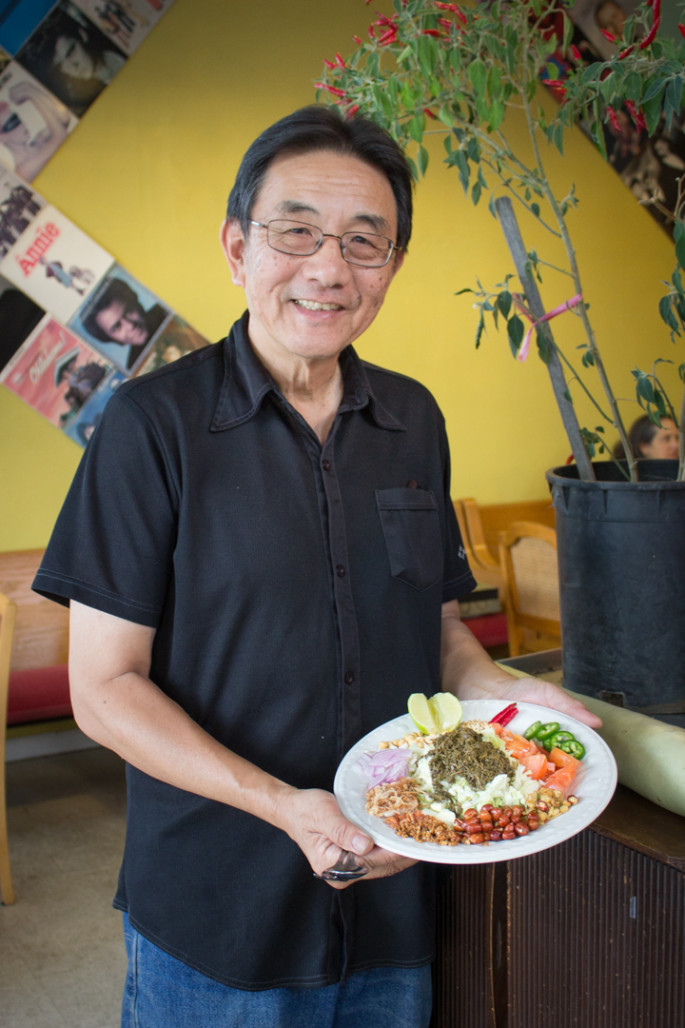 William Lue with the signature Burmese tea leaf salad at Grocery Cafe. Photo: Benjamin Seto