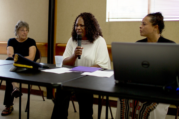 Eve Ahmed (center) describes the city's approach to mental health outreach. Photo: Emilie Raguso