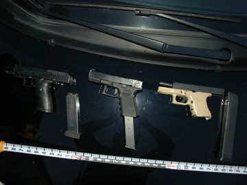 The confiscated weapons, with the one in the middle being an imitation handgun. Photo: BPD