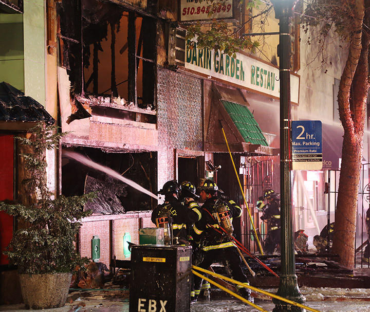 Firefighters fight a fire at the Mandarin Garden restaurant, in Berkeley, on Friday, Nov. 27, 2015. Photo: David Yee ©2015