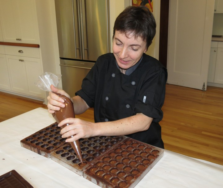Pascale Martin at work piping chocolate in her home. Photo: Geoffroy Martin