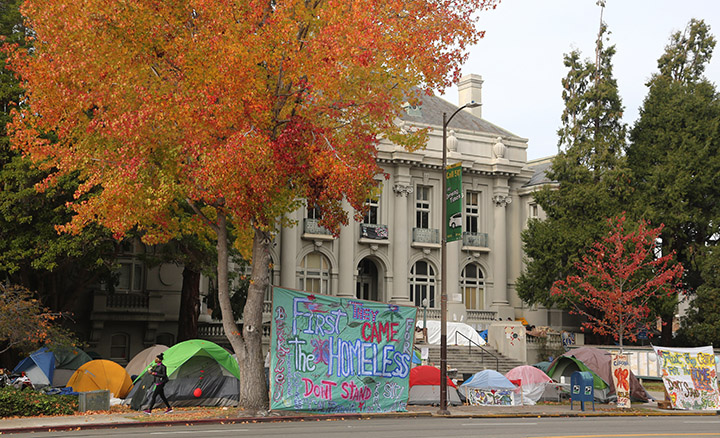 Residents of a homeless encampment remain on the grounds of Old City Hall in what they say is a protest of new laws passed this week by the City Council. Photo: David Yee