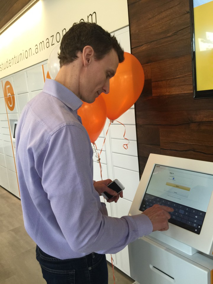 MacDonald demonstrates how to use the kiosks at the new Amazon store to print out a return label. Photo: Frances Dinkelspiel