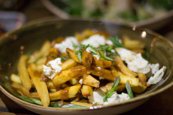 Poutine with fries, double duck gravy, and cheese curds ($13) at Drake's Dealership. Photo: Benjamin Seto