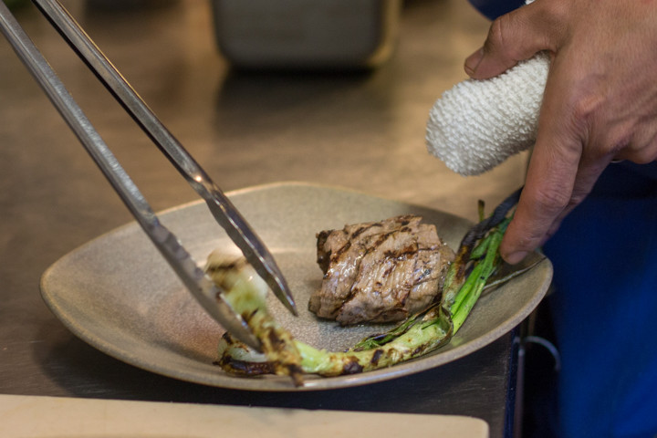 The meat and vegetables are added to the plate. Chef Ramos rolls the beef into a ball to keep them warm and moist. Photo: Benjamin Seto
