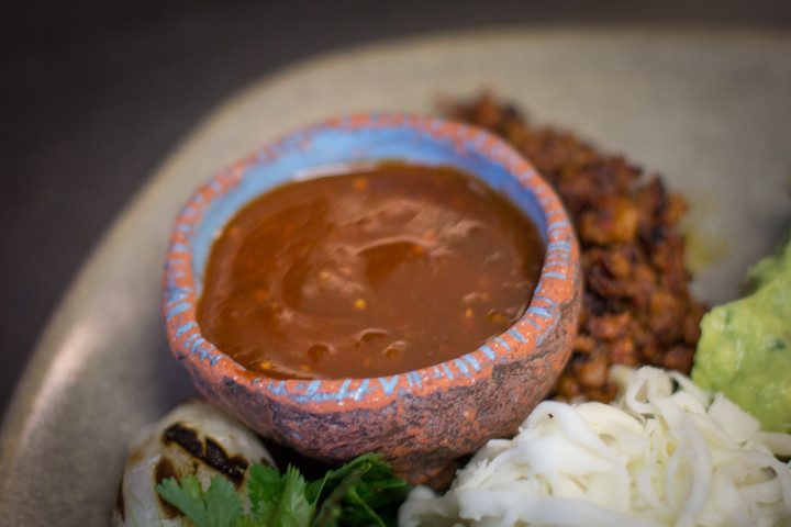The dish is served with a chile pasilla salsa. Photo: Benjamin Seto