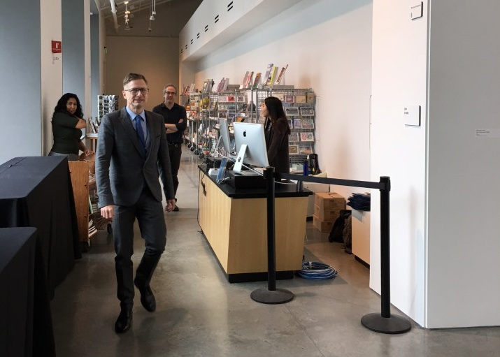 Charles Renfro (foreground), a partner in the architecture firm Diller Scofidio + Renfro who designed the new museum, walks through the new BAMPFA museum shop. Photo: Tracey Taylor