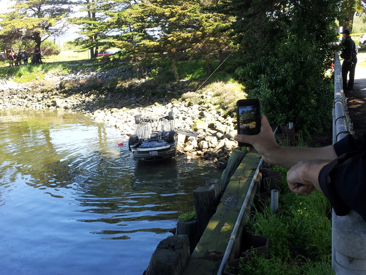 Authorities worked to remove the car from the Berkeley Marina on Sunday afternoon.