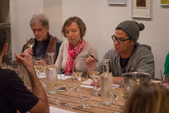 Bay Grape owner Josiah Baldivino (far right) leads one of its weekly Blind Tasting Wine Classes. Photo: Benjamin Seto