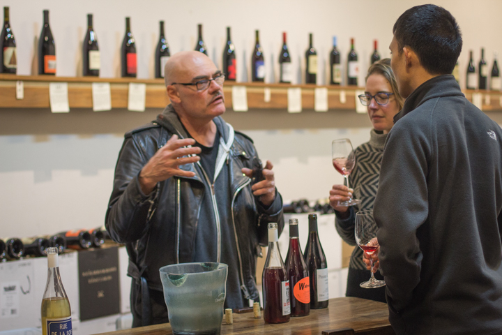 Brendan Tracey, left, a small producer making wine in Sainte Anne, France, chats with customers at a recent winemaker tasting at Vintage Berkeley's Elmwood store. Photo: Benjamin Seto