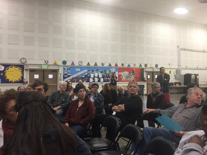 Local residents turn their heads to listen to testimony from a fellow neighbor at Sunday's neighborhood public safety meeting. Photo: Emily Dugdale