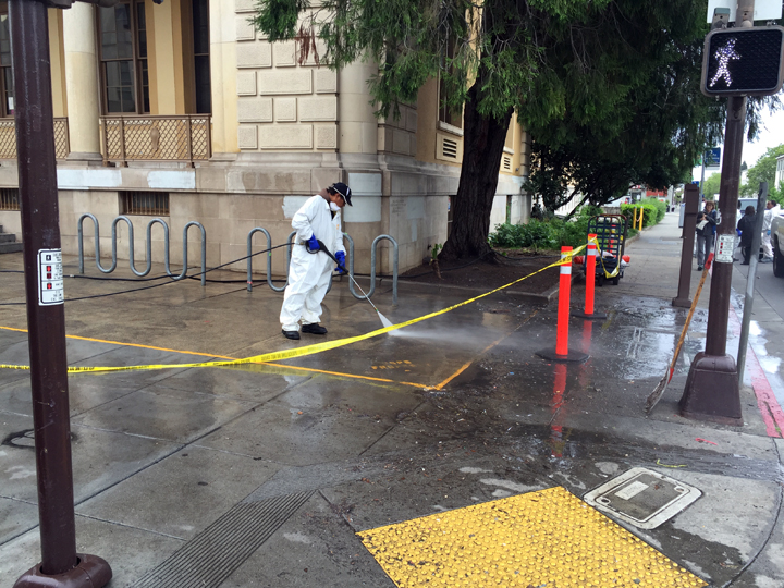 Power washing the sidewalk outside the downtown Berkeley Post Office. Photo: Stuart Pawsey