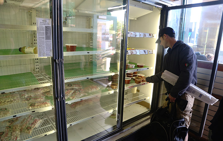 A customer looks at a picked-over freezer case at Genova Delicatessen, in Oakland, California, on Friday, April 29, 2016. The 90-year-old Oakland institution is set to close tomorrow. Photo: David Yee ©2016
