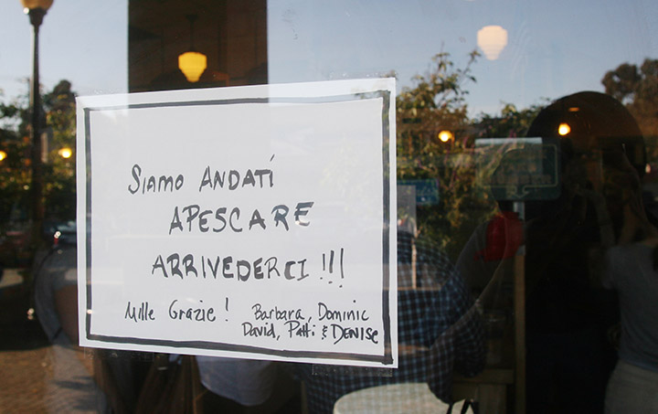 "A ""gone fishing"" sign written in Italian hangs on the door of Genova Delicatessen, a few minutes after its announced final closing time, with dozens of customers still packed in the store, in Oakland, on Saturday, April 30, 2016. Photo: David Yee ©2016"