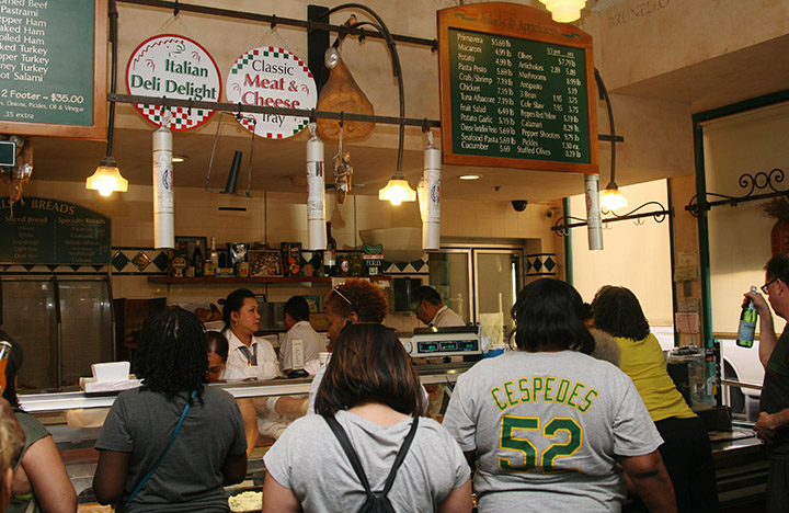 Dozens of customers still crowd Genova Delicatessen after closing time, on its final day of business, in Oakland, on Saturday, April 30, 2016. Photo: David Yee ©2016