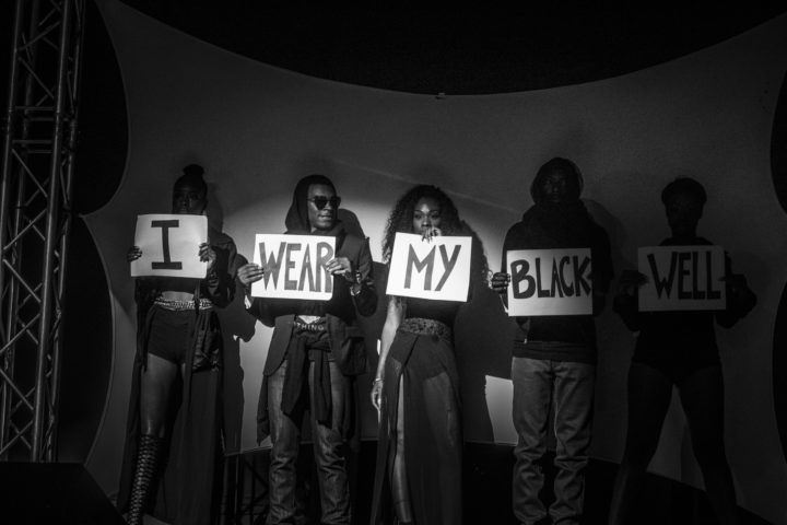 "Models holding signs that read: ""I wear my Black well"" Photo: courtesy of Mecca Media"