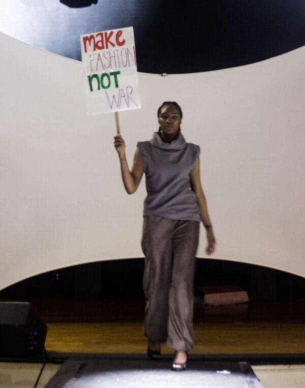Model walks runway during 'Controversy' fashion show. Photo: courtesy of Mecca Media