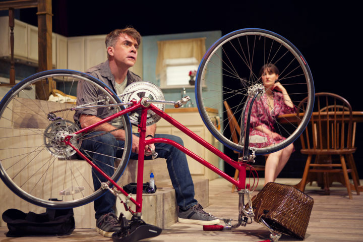 Kevin Clarke as Oliver, Elissa Stebbins as Becky in The Village Bike. Photo: Pak Han