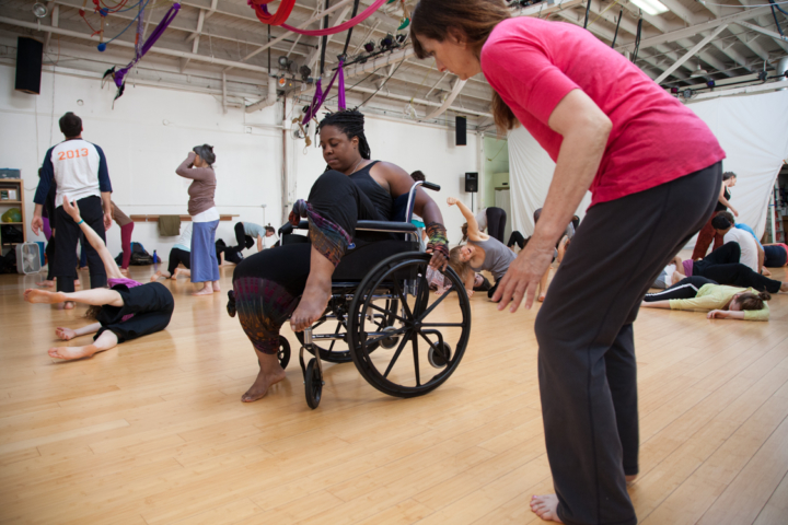 India Harville, a certified DanceAbility instructor who sometimes uses a wheelchair, dances with a partner using a chair at the DanceAbility workshop during wcciJAM 2016. DanceAbility is designed to be inclusive of all kinds of bodies, and to teach participants to be receptive to all new forms of movement; to break habits and patterns of thought in a supportive atmosphere. Photo: Kelly Sullivan