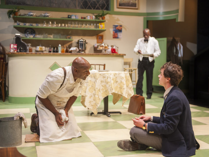 Hally (r. Andrew Humann) chats with Willie (l. Adrian Roberts) after school while Sam (c. L. Peter Callender) prepares his lunch in Aurora Theatre Company's Master Harold…and the boys. Photo: David Allen