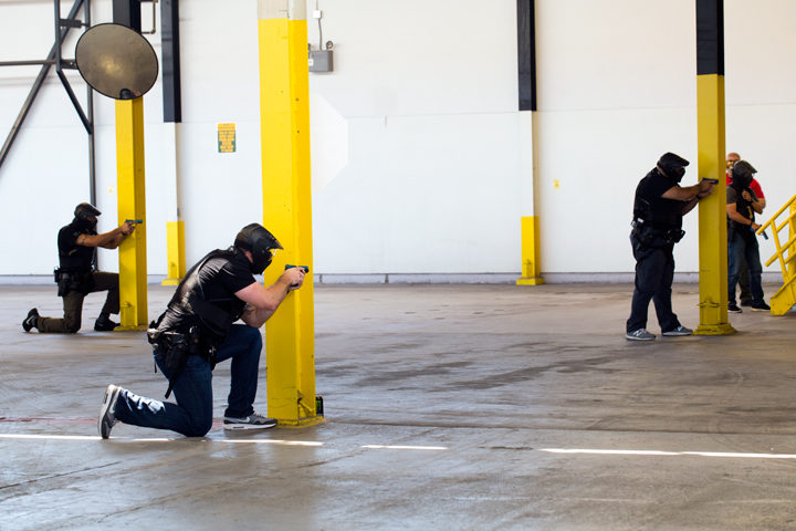 Officers respond to a domestic dispute drill involving a hostage and an armed man. (The helmets they are wearing are safety gear due to the type of rounds used in the training exercise.) Photo: Emilie Raguso