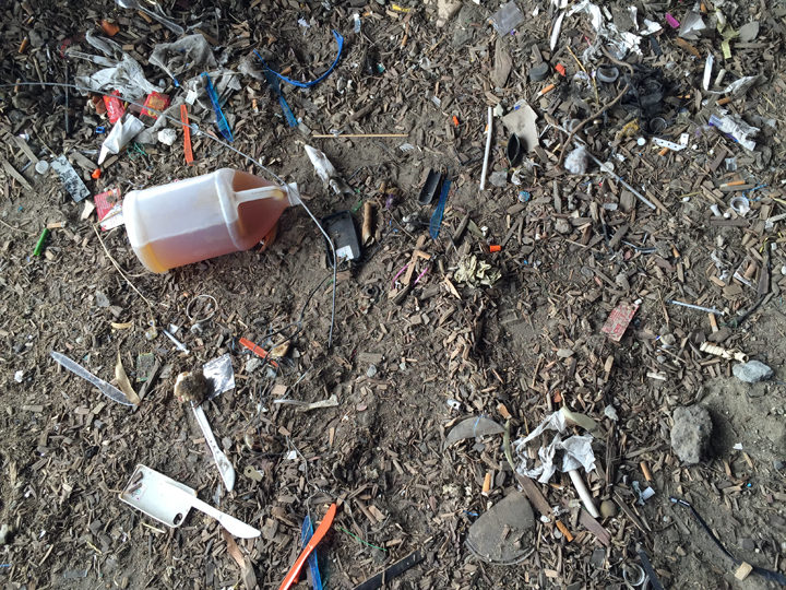 Garbage and bottles of what appeared to be urine were still on the ground after the clean-up beneath the freeway. Photo: Emilie Raguso