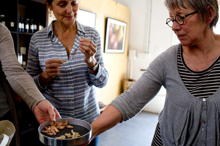 June Taylor (right) hands out samples of citrus candies at her shop in West Berkeley. Photo: Emilie Raguso