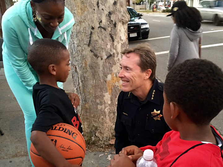 BPD Chief Michael Meehan plays ball with the kids during National Night Out in August. Photo: Courtesy of Chief Mike Meehan